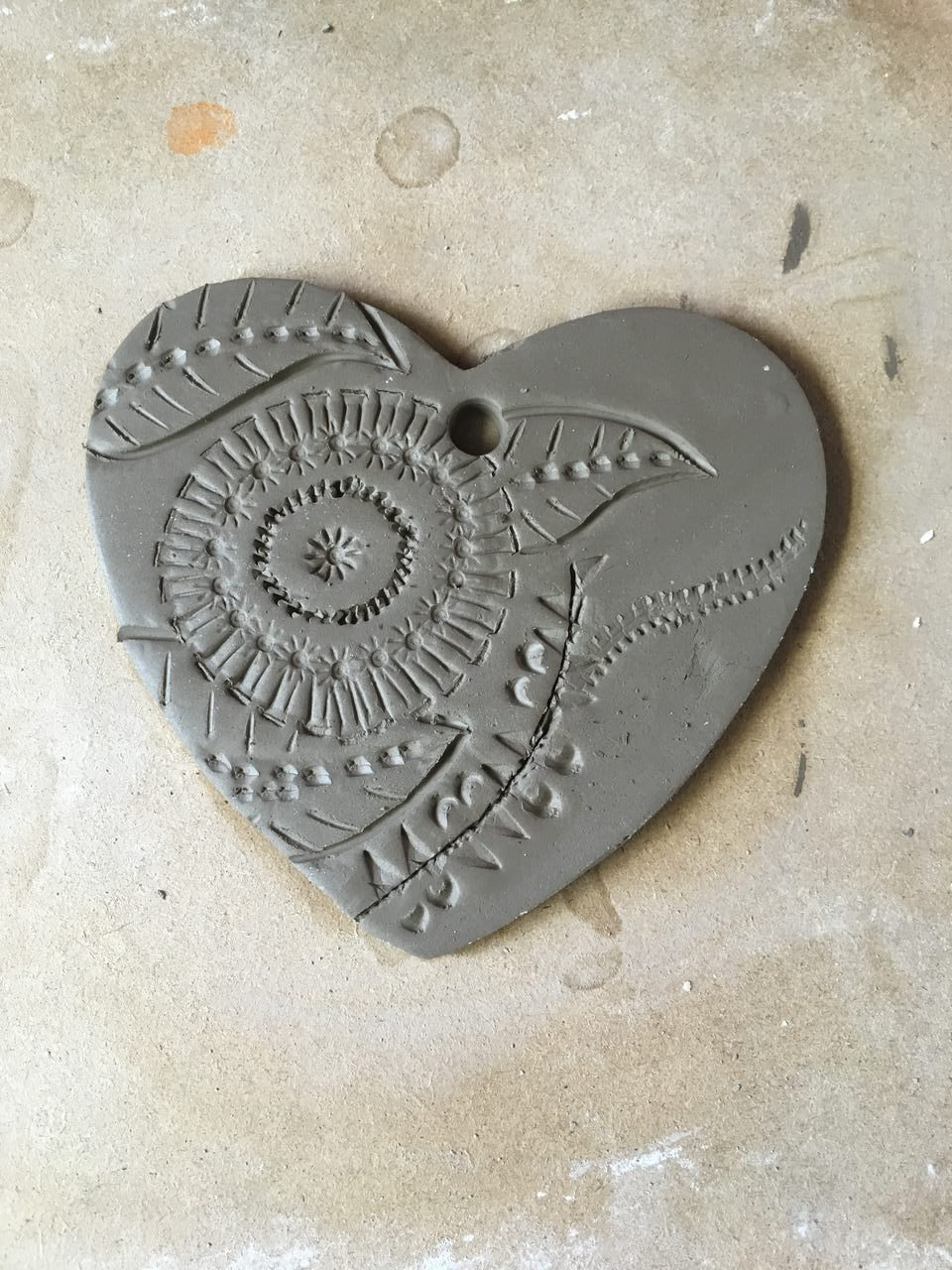 Decorating a Pottery Heart in progress