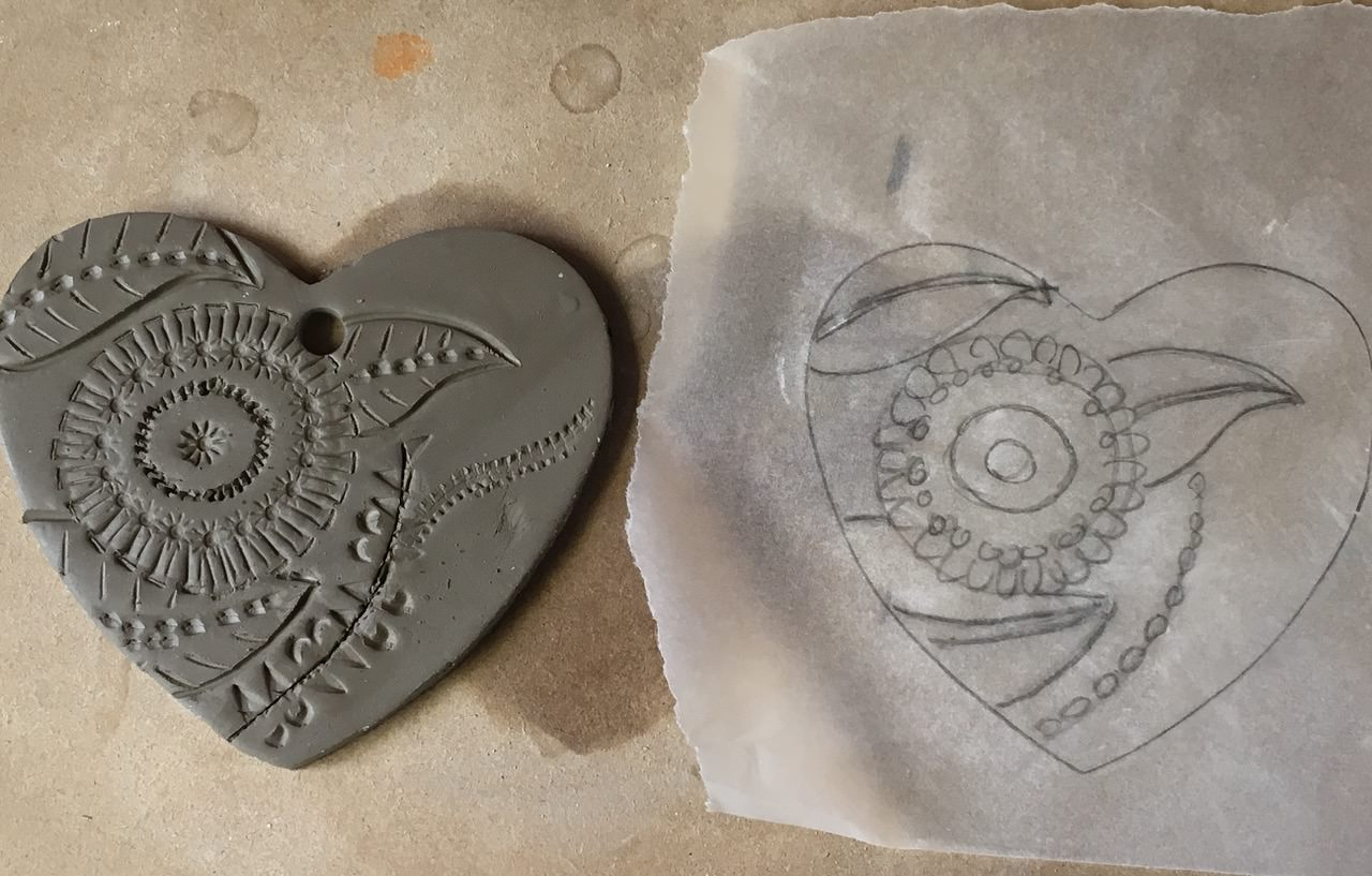 Imprinting a design in order to decorate a Pottery Heart