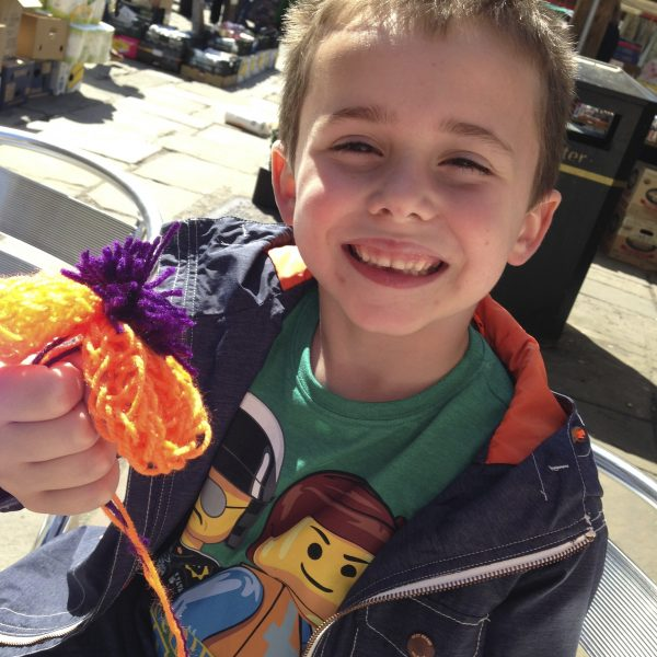Connor with his finger knitted flower