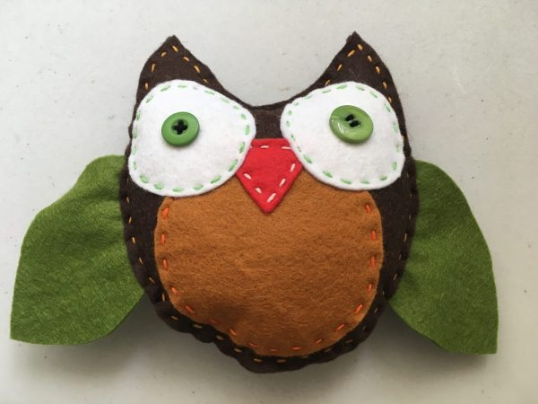 Hand sewing owl