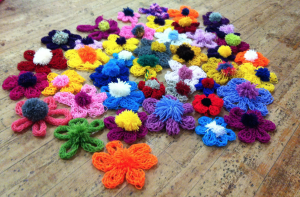 Lots of finger knitted flowers