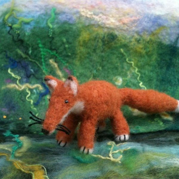 Needle felted fox in woodland scene